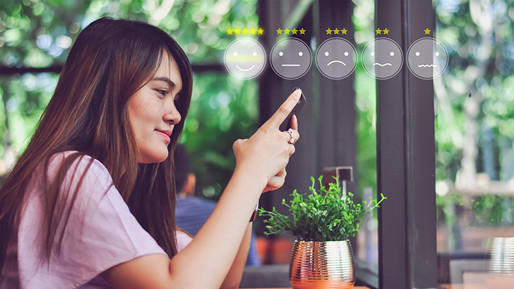 woman on phone with smiley face icons