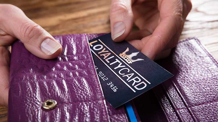 person pulling credit card out of wallet