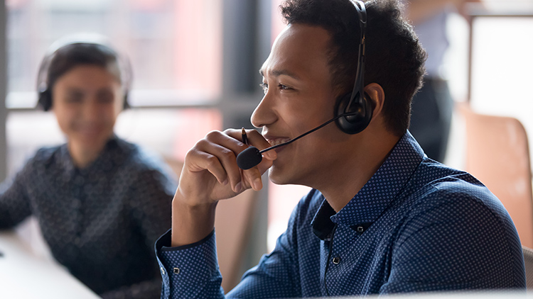 man in call center with headset on