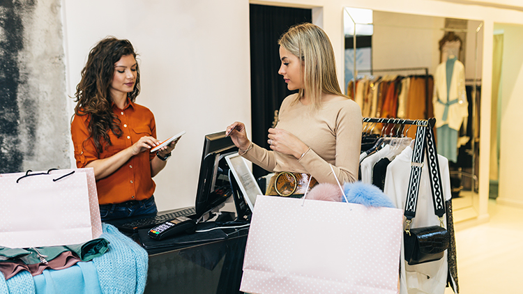 woman in store shopping with phone