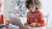 lady in christmas sweater at computer