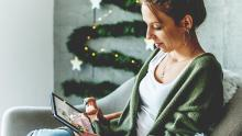woman shopping on tablet during holidays
