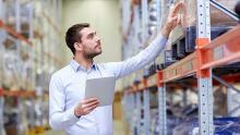 man working in warehouse with inventory