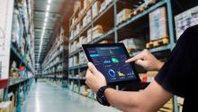 person using tablet in warehouse